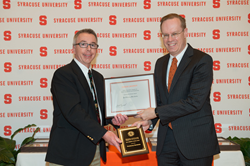 Kevin Morgan (left), president and CEO of ProLiteracy, accepts the Community Partner Award from the Chancellor of Syracuse University, Kent Syverud.