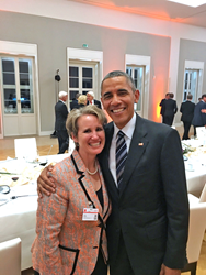 Natalie Kaddas and President Barack Obama at a dinner in Germany.