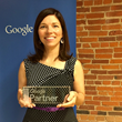 Linda Girard, CEO of Pure Visibility, holding Google Premier Partner plaque.