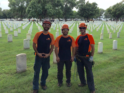 SAVATREE CREW VOLUNTEERS AT FORT SNELLING NATIONAL CEMETARY FOR SALUTING BRANCHES