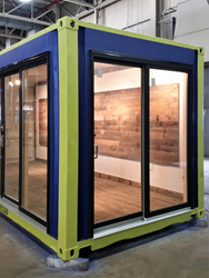Abundant history from Pioneer Millworks reclaimed wood now lives in the modest re-purposed interior of a shipping container at Greenbuild 2016.