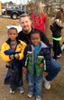 Pastor Howard with two kids at a previous event. The church is involved in a variety of local and international outreach activities.