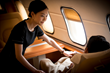 L'VOYAGE flight attendant serves a private jet customer from China