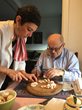 Stephanie Levine, founder of TOHI Wellness, works with Alliance Homecare client Dr. Gad Avigad to prepare an organic lunch.
