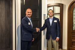 Glenview Haus Owner Greg Wozniak shakes hands with TruStile President and CEO Scott Schmid