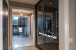 Wine Cabinet in Hallway of Minimalist Transitional Home
