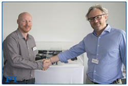 Stéphane Bussa (right), Vice President of Sales & Marketing, congratulates Dr. Cliff Jolliffe on his appointment to head PI's precision automation market segment (Image: PI)