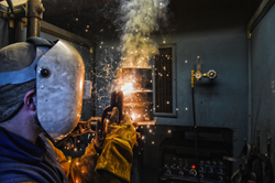 A student in one of SLCC's welding courses.