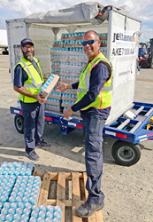 American Airlines personnel unloading CW4K canned water in Puerto Rico