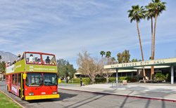 Photo of Modernism Week's iconic Double Decker Bus tour in front of Palm Springs City Hall