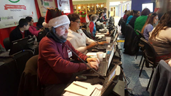 Volunteers from Neighborhood Credit Union take calls from donors at the 2016 Christmas for Children Radiothon.
