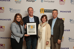 Access Development executives pose with their Top Workplaces Award, presented by the Salt Lake Tribune