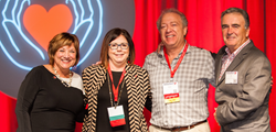 Martha Lopez-Anderson and Steve Tannenbaum, Parent Heart Watch (center), accept video contest award from Mary Newman, Sudden Cardiac Arrest Foundation and Edward Stapleton, Citizen CPR Foundation.
