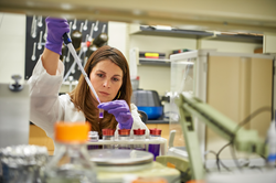 Nicole Wagner, CEO of UConn TIP company, LambdaVision, works in the lab (UConn Photo)