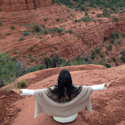 Goddess sitting among Sedona Red Rocks