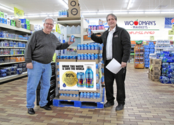 Greg Stromberg, CW4K Founder & CEO (left) and Steve Affeldt, Water Category Manager at Woodman's Markets with CW4K drinking water in-store.