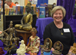 A vendor specializing in Buddhas at Victory of Light.