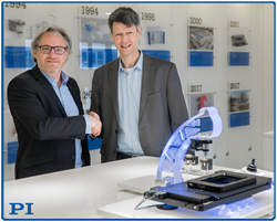 Stéphane Bussa, Vice President of Sales & Marketing, congratulates  Dr. Thomas Bocher on his appointment as Head of Segment Marketing  Microscopy & Life Sciences