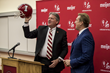 Indiana University Vice President and Athletic Director Fred Glass presents Terry Tallen with his 1979 Holiday Bowl helmet at the 1999 Holiday Bowl scholarship fundraiser.