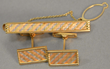 DR monogrammed Mitsubishi 18k cufflinks and tie clip set, estimated at $400-600.