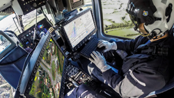 The UK National Police Air Service (NPAS) mission crew use CarteNav's AIMS-ISR® software on an aerial surveillance mission.