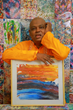 Parijoy Saha with the World's fastest abstract painting made in a 1/5th fraction of a second.