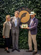 Simon Burvill and Butter Wakefield receive the Best Tradestand award from RHS President Sir Nicholas Bacon Bt, OBE, DL at the RHS Chelsea Flower Show 2018