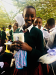 Tanzanian School Girl Receiving Sanitary Pads and Undergarments