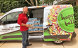 Al Reis of Happy Bellies Bakery loads aluminum bottles of cw4k drinking water into van