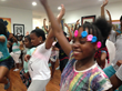 "Young ladies demonstrate a ""tree pose"" (yoga position) with their eyes closed, during Bailey's Café's six-week free arts-based rites of passage summer program for young people ages 9 to 19. The lessons focus on specific artistic disciplines and explore self-expression, creativity, self-discipline and confidence building."
