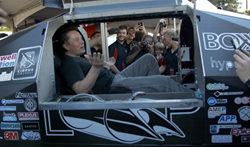 Elon Musk sitting in the Badgerloop Pod