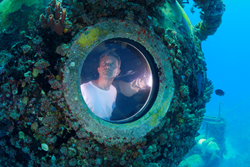 Aquanaut Fabien Cousteau inside Aquarius, an undersea laboratory, during Mission 31