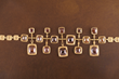 Long Shadows by Audrius Krulis. Rose Cut Diamonds, Brown Diamonds, and 18K Yellow Gold Necklace