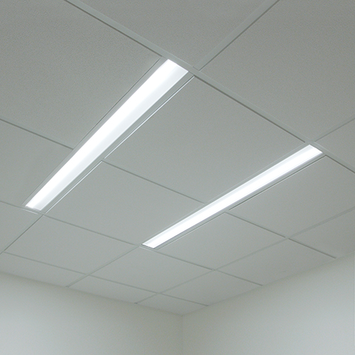Clean modern linear light over the patient bed brings design cohesion with other areas of the hospital. & New Lighting Technology Makes Space on Patient Room Ceilings