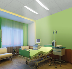 Dual overbed slot lighting in a green patient room
