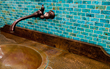 Exhibitor Gemstone Tiles creates stunning tiles such as this turquoise backsplash, one of many unique Western Design products that make home décor more artful and meaningful.
