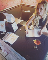 Nichole Eaton signing copies of her life-changing book, Rock Your Soul, at New York launch party