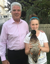 Mayor Mayor Philip J. Guenther, his niece Megan Baldwin, and Baldwin's pet duck Lucy proudly stand for photo after receiving award.