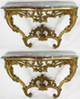 Pair of 18th century Louis XV giltwood console tables, each with serpentine form rosso antico marble
