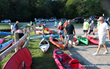 Paddlers assemble their canoes for the annual Paddle or Battle Race on the Appomattox River in Hopewell-Prince George VA.