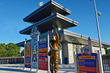 A.J. Foyt bronze sculpture next to miniature Indianapolis Motor Speedway pagoda