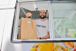 Patrick Lyne of Farm&Haus serves from his new FLEAT mobile storefront.