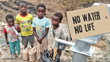 Young boys in Africa collecting water