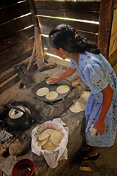 Belize Woman Makes Corn Tortillas over Open Hearth
