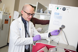 Maciej Goniewicz, PhD, PharmD, shown in the Tobacco Research Laboratory at Roswell Park, is first author on a new study reporting higher levels of nicotine exposure for users of 'pod' e-cigarettes