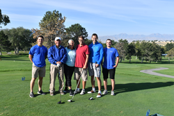 Clint Ensign (second from left), family members and two SLCC students (far left and right) pose at one of the Hidden Valley holes.