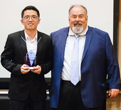 President Steve Burgess awards Distinguished Student award to Qi Li