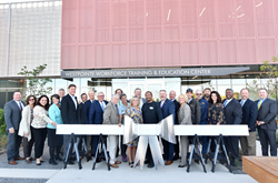 "SLCC celebrated the opening of its new Westpointe Workforce & Technical Education Center with a ribbon ""joining."""