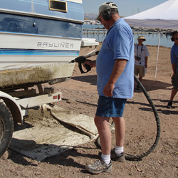 A person demonstrating a way to clean a boat after being in infected waters.