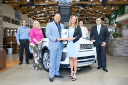 Warren Henry Auto Group's Land Rover South Dade staff accepting the 2018 JD Power - Dealer of Excellence Award. The auto group also received Power of Excellence awards for Warren Henry Jaguar and Warren Henry Infiniti.
